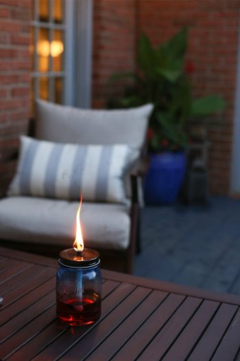 Here are 15 different types of backyard Tiki torches to inspire your outside entertaining this summer! These ideas include Tiki torches you can DIY. Don't miss it!