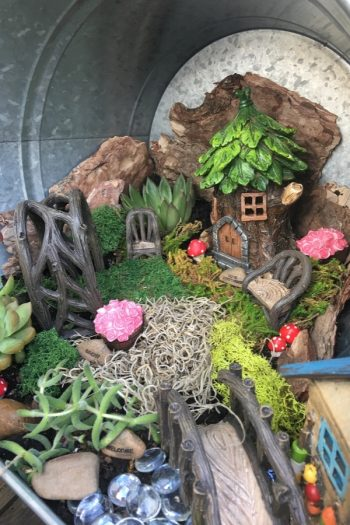 If you've ever thought about putting in a fairy garden in your garden, I highly recommend it. For more garden art ideas, look hrere.
