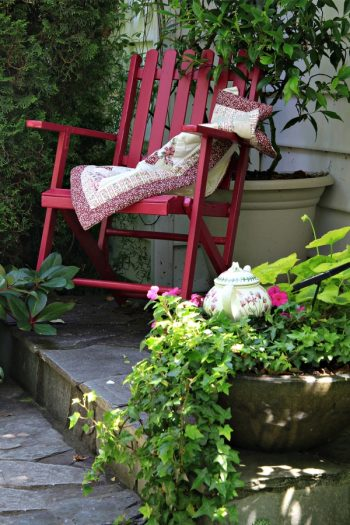 There's no denying the charm of a cottage flower garden. Did you know you can extend that charm all the way through to your front porch? I love giving a porch the look of a cottage flower garden, and you can too. Having chairs or benches is important so you can sit and enjoy your yard.