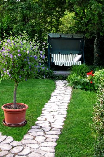 If you have a garden, but not a rock pathway, it's time to fix that right now. Today I have rock pathway ideas to inspire any gardener to make a beautiful garden just that much better. A rock pathway makes a statement that bids the beholder to follow, to more fully enjoy the garden and take time to smell the roses. See how you can DIY your own rock pathway.