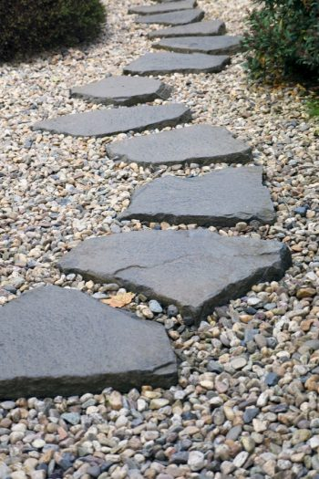 If you have a garden, but not a rock pathway, it's time to fix that right now. Today I have rock pathway ideas to inspire any gardener to make a beautiful garden just that much better. A rock pathway makes a statement that bids the beholder to follow, to more fully enjoy the garden and take time to smell the roses. These stones would look great in any yard.
