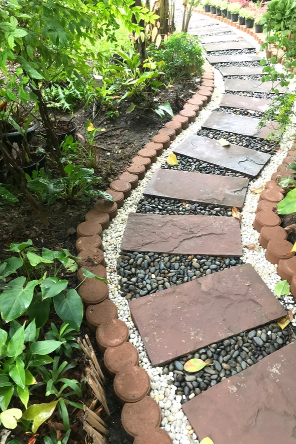 If you're like me, you've got a little extra time on your hands right now, so why not spend it in your yard if the weather cooperates? Here are some fun DIY yard ideas to make your outdoor living space the best yet! You will love having this pathway in your yard.