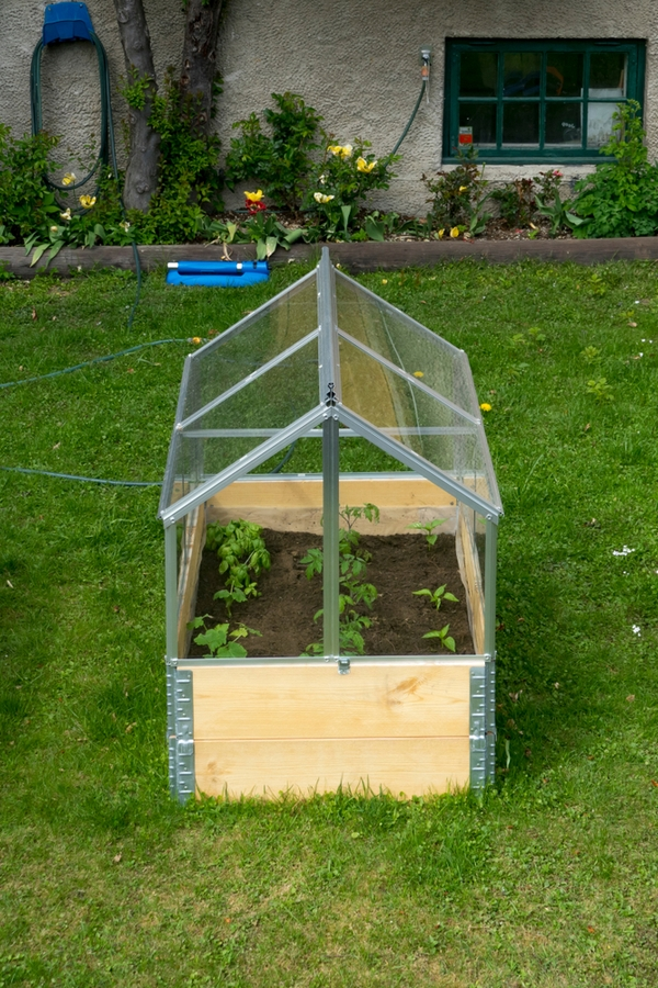 If you're like me, you've got a little extra time on your hands right now, so why not spend it in your yard if the weather cooperates? Here are some fun DIY yard ideas to make your outdoor living space the best yet! You will love this DIY greenhouse.