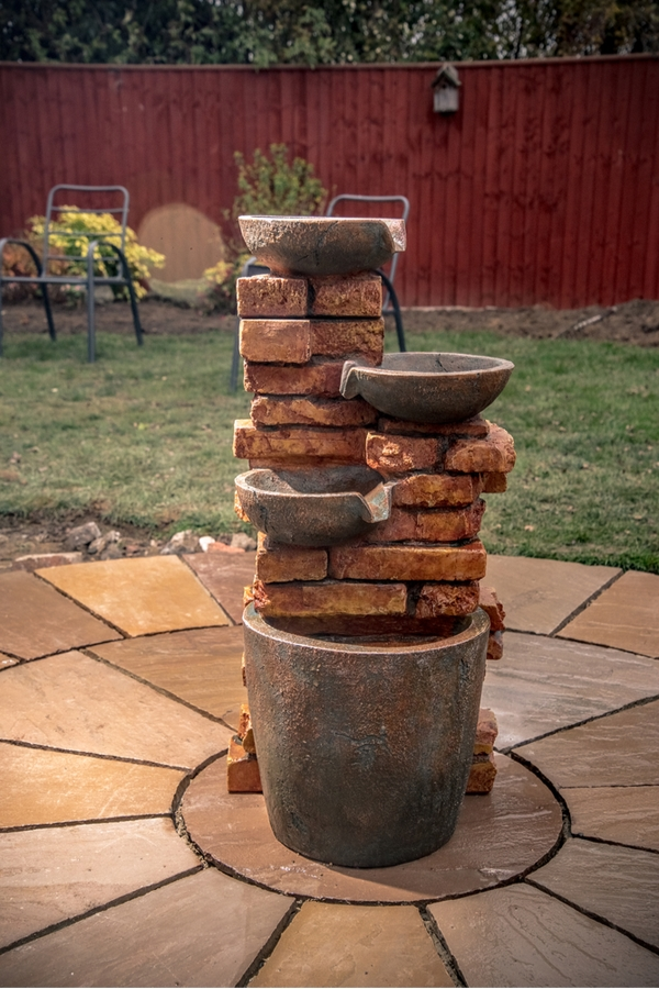 If you're like me, you've got a little extra time on your hands right now, so why not spend it in your yard if the weather cooperates? Here are some fun DIY yard ideas to make your outdoor living space the best yet! You will love this water feature in your back yard.