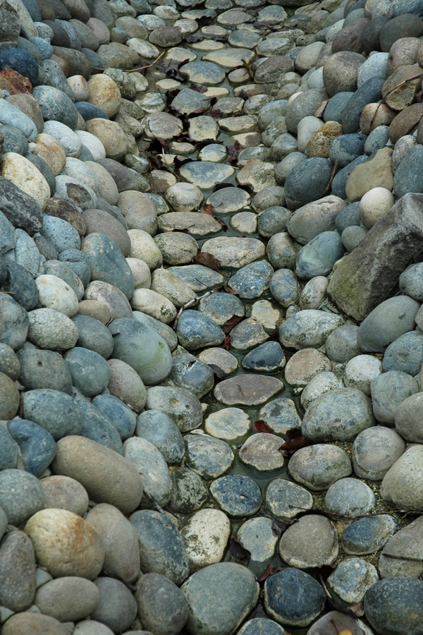 If you're like me, you've got a little extra time on your hands right now, so why not spend it in your yard if the weather cooperates? Here are some fun DIY yard ideas to make your outdoor living space the best yet! You will love this dry creek bed in your back yard.