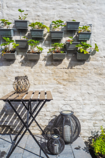 DIY small patio ideas on a budget are perfect for those DIYers with small yards, patios, or even apartment-dwellers with balconies. Even if your patio is only a few feet square, there are things you can do to enjoy it to its fullest.